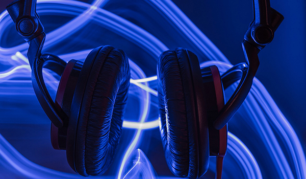 close up headphones and blue sound waves showing sound
