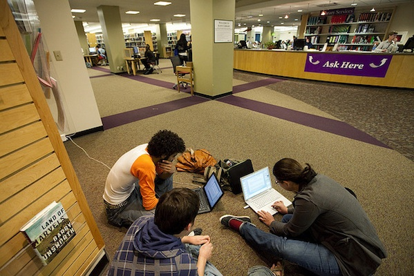 group of students studying working together in library