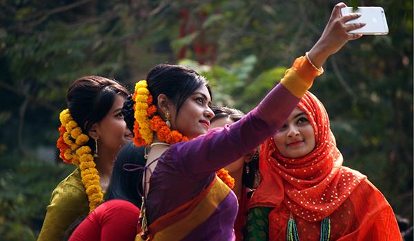 5 indian women outside taking a selfie