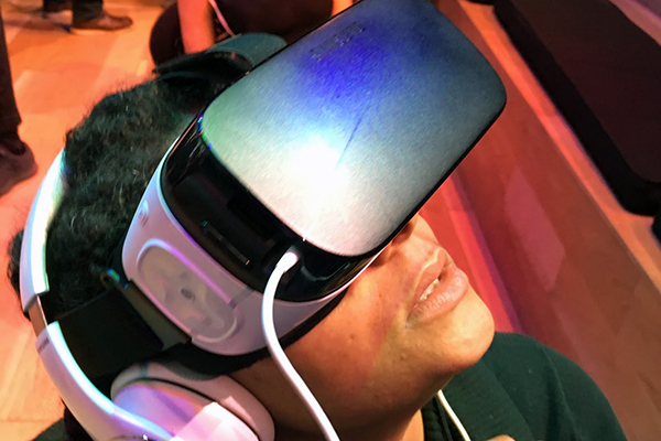 Boy wearing virtual reality headset and earphones