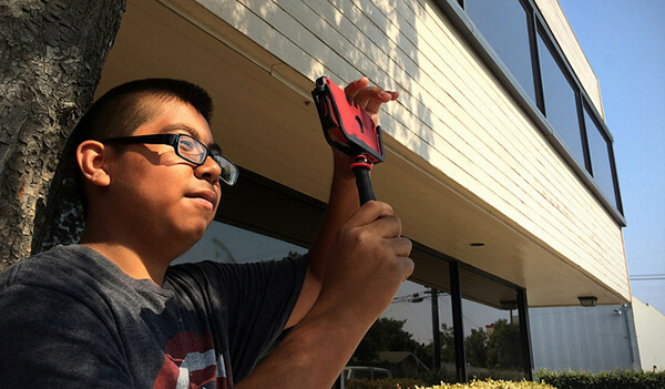 Student takes a photo with a mobile device