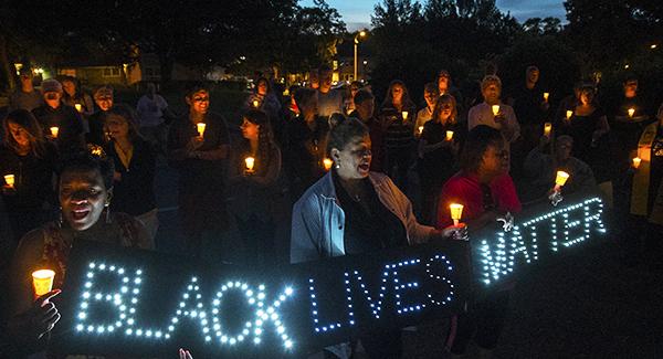 large group gathering for black lives matter march vigil