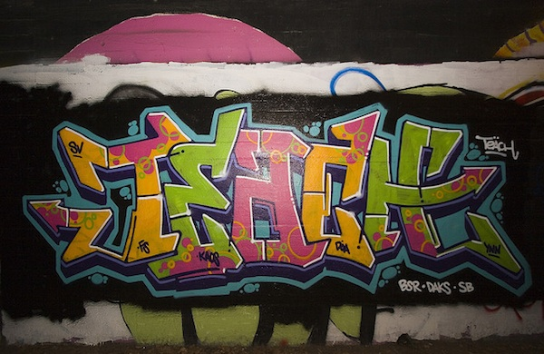 colorful graffiti written on brick wall